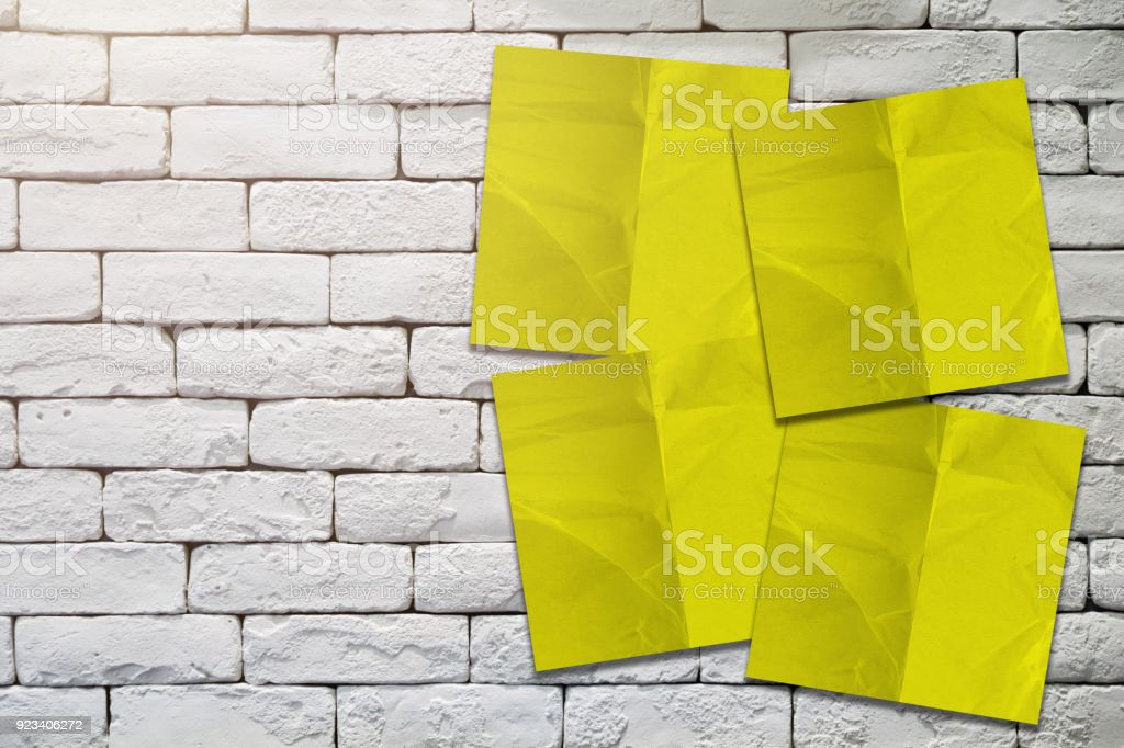 Yellow Paper Notepad Stick On White And Old Rustic Brick