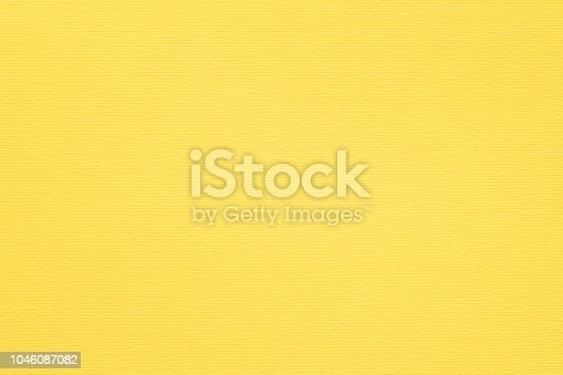 yellow paper texture background. colored cardboard fibers and grain. empty space concept.