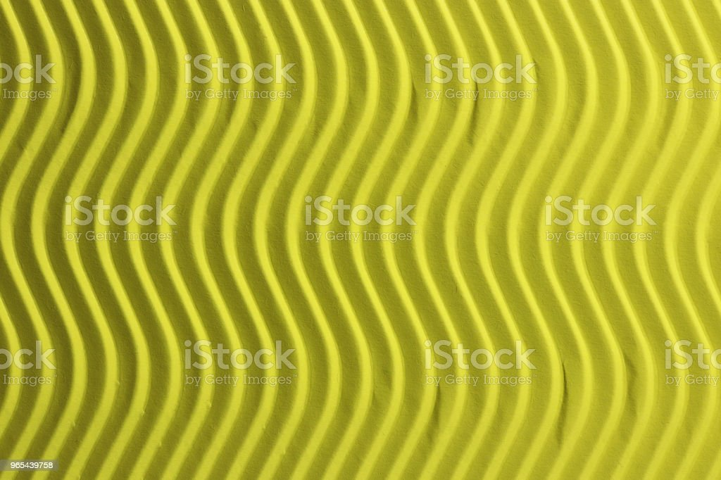 Yellow Paper Vertical Waves Texture. Embossed Waves on Detailed Paper Background. Corrugated Wavy Cardboard Backdrop. zbiór zdjęć royalty-free