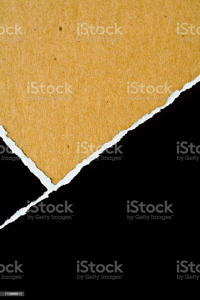 Yellow paper with torn white strip on a black background royalty-free stock photo