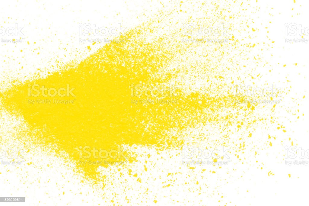 yellow particles explosion on white background stock photo