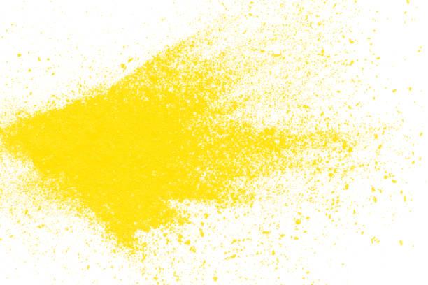 explosão de partículas amarelas sobre fundo branco - foto de acervo