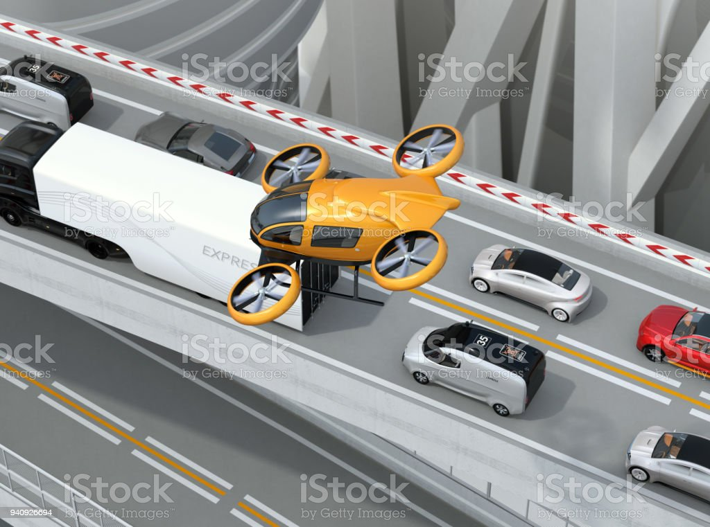 Yellow passenger drone flying over cars in heavy traffic jam stock photo