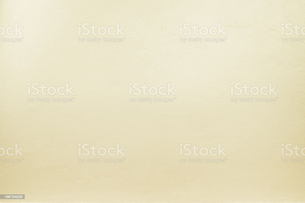 yellow pastel color paint on cement wall, Texture background stock photo