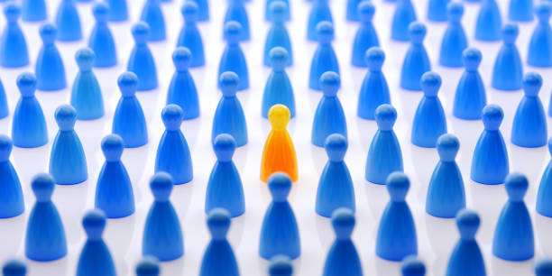 Yellow Pawn Standing Out From The Crowd stock photo