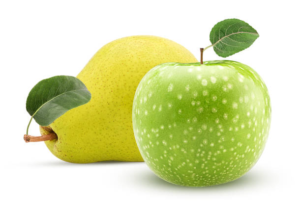 Yellow pear and green apple with leaf stock photo