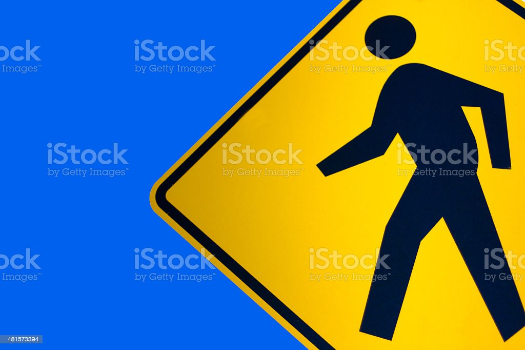 Yellow Pedestrian Crossing Sign And Bright Blue Sky stock photo