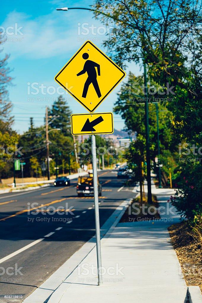 Yellow pedestrian crossing sign in California, USA stock photo