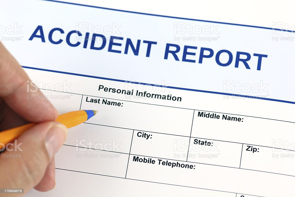 Yellow pen filling out an accident report form royalty-free stock photo
