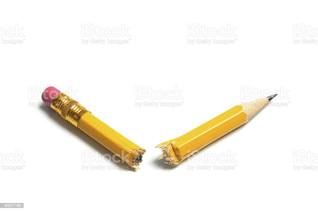 A yellow pencil broken into two isolated on white royalty-free stock photo