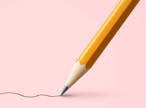 Yellow pencil drawing line on pink background stock photo