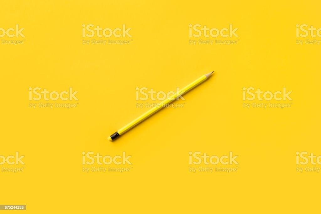 Yellow pencil isolated on yellow stock photo
