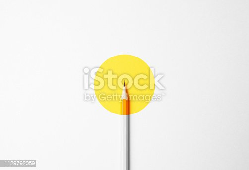 Yellow pencil on a white background, minimalism. Abstract art, imagination, education.