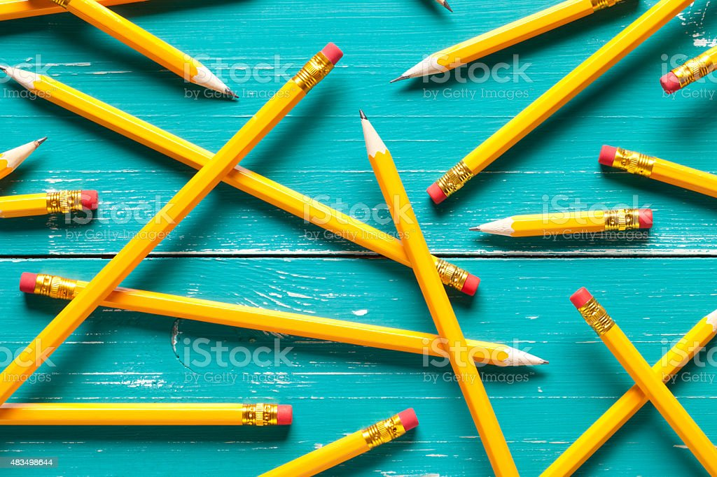 Yellow pencils on turquoise table stock photo