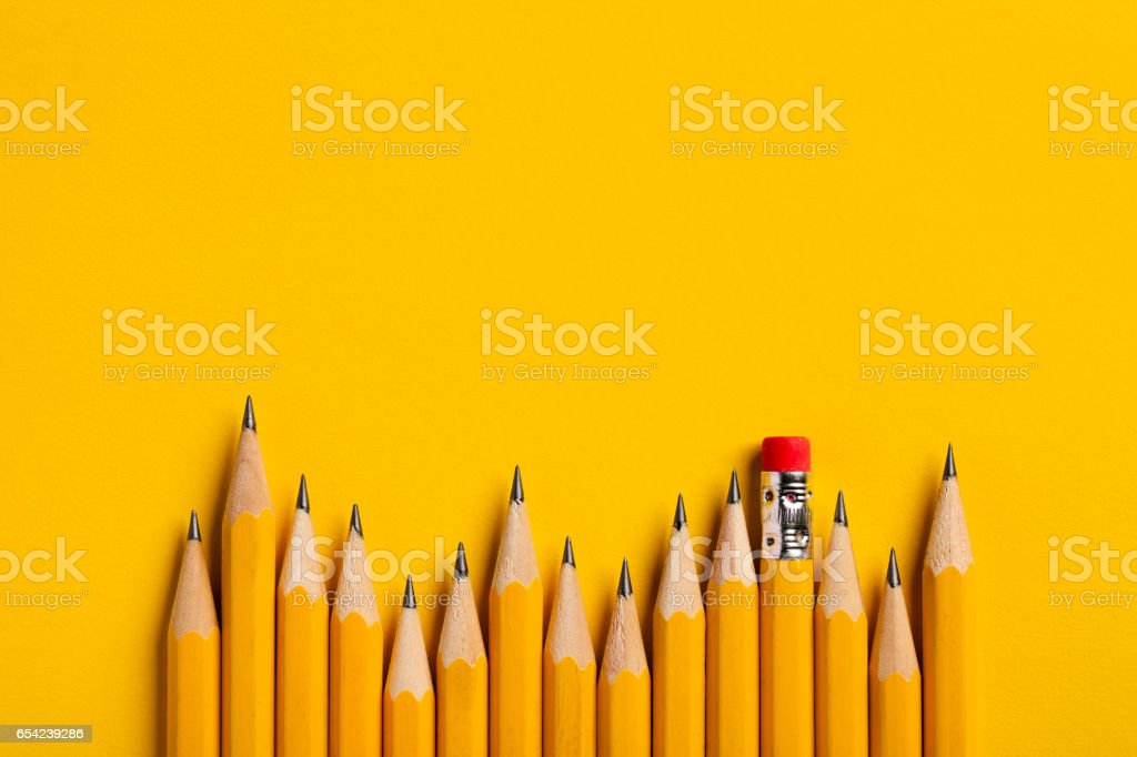 Yellow Pencils on yellow paper stock photo