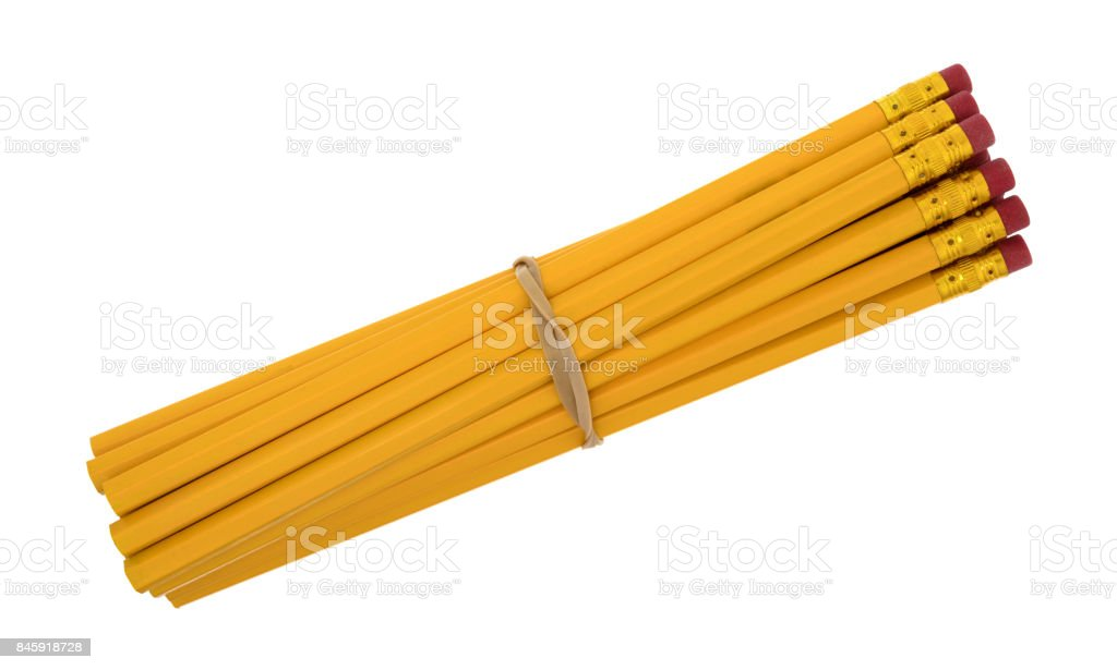 Yellow pencils with a rubber band stock photo