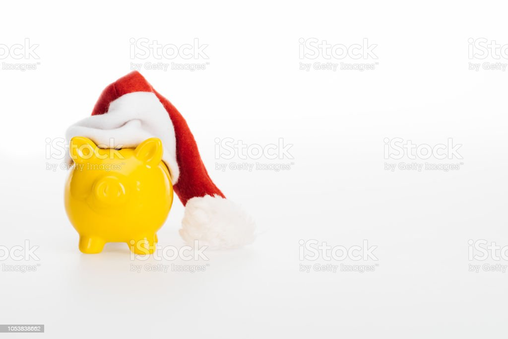 09d031a81 Yellow Piggy Bank In Santa Hat Isolated On White Stock Photo ...