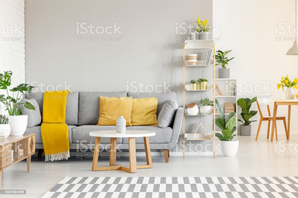 Yellow Pillows And Blanket On Grey Sofa In Modern Living
