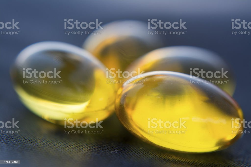 Yellow Pills Blue Background royalty-free stock photo