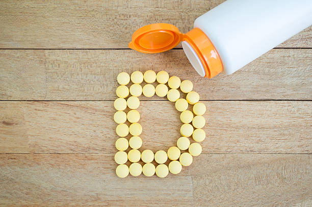 Royalty free letter d pictures images and stock photos istock yellow pills forming shape to d alphabet on wood background stock photo altavistaventures Image collections