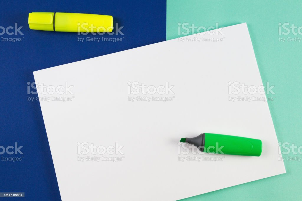 Yellow, pink and green highlighters markers with blank sheet of paper on colorful background. royalty-free stock photo