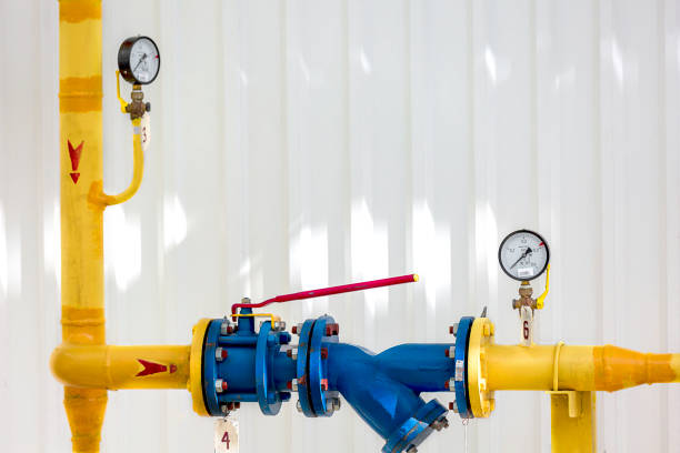 Yellow Pipeline with couple of pressure gauges on it stock photo