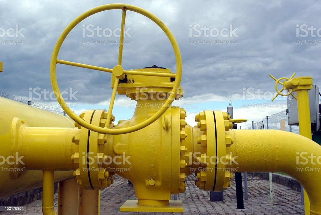 yellow pipes and valve royalty-free stock photo