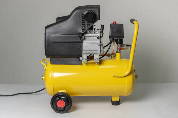 Yellow Piston Air Compressor. Compressing and Supplying Air Machine. Yellow Piston Air Compressor. Compressing and Supplying Air Machine. Technical Equipment. compressor stock pictures, royalty-free photos & images