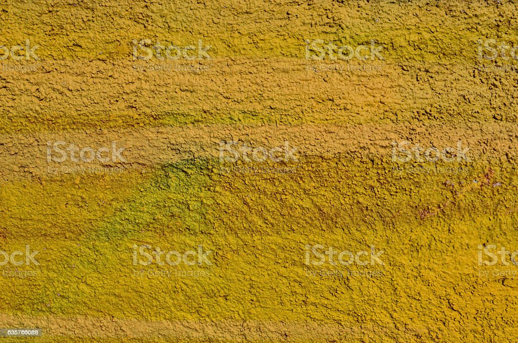 Yellow plastered wall stock photo