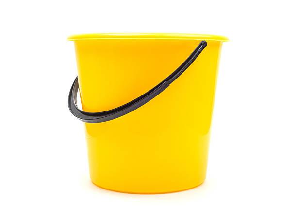 yellow plastic bucket - emmer stockfoto's en -beelden