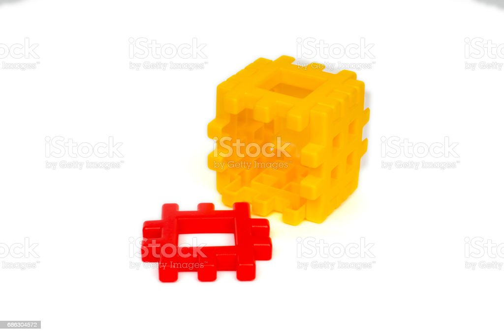 Yellow plastic building blocks cube without front face stock photo
