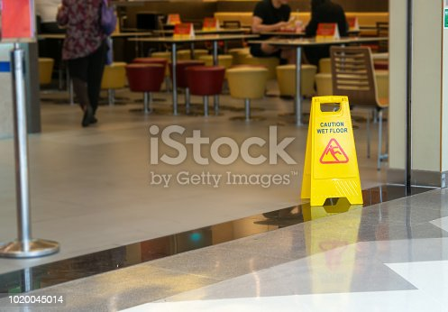 istock yellow plastic cone with sign showing warning of wet floor in restaurant in department store 1020045014