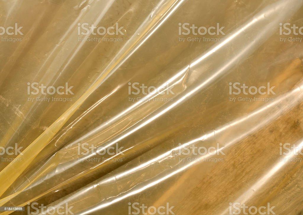 Yellow plastic film texture in sunlight. stock photo