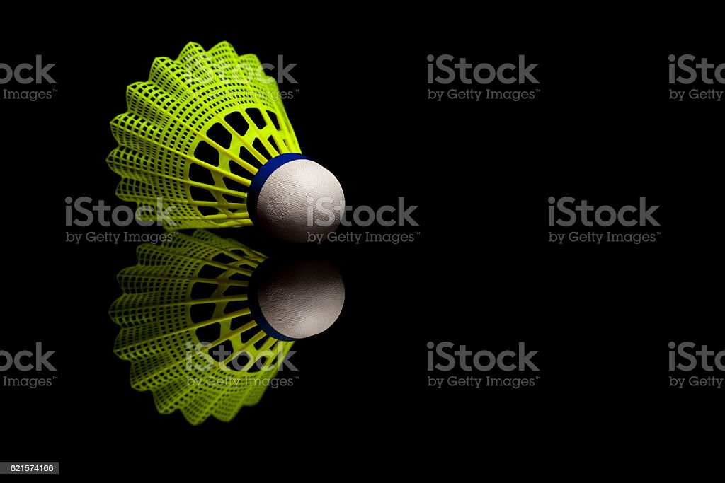 Yellow plastic shuttlecocks with blue strip isolated on black photo libre de droits