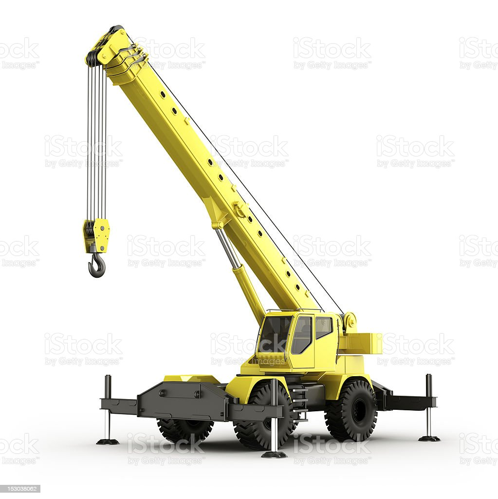 A yellow plastic toy mobile crane stock photo