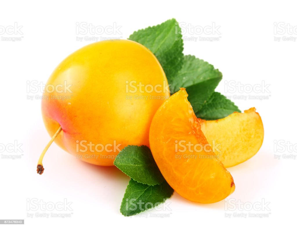 Yellow plum and slices with leaves isolated on white background stock photo