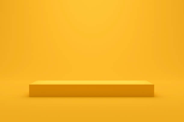 Yellow podium shelf or empty studio display on vivid summer background with minimal style. Blank stand for showing product. 3D rendering. stock photo