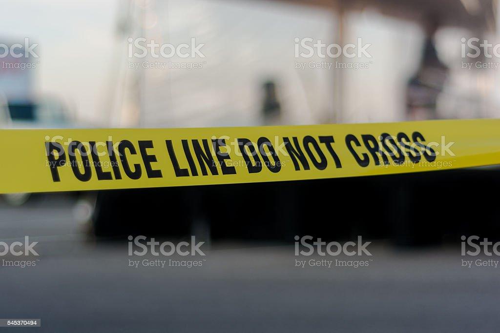 Yellow police line tape stock photo