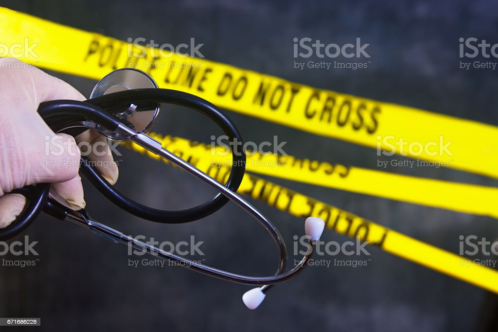 Yellow police tape cordons off a restricted area stock photo