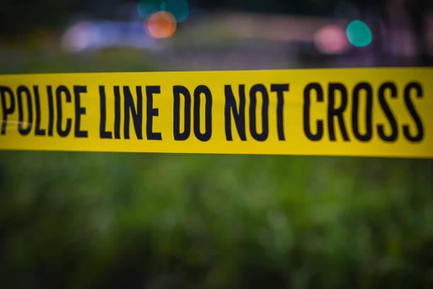fita amarela da polícia - violência - fotografias e filmes do acervo