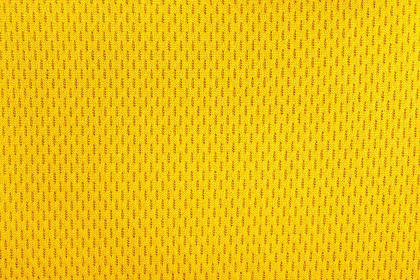 yellow polyester nylon sportswear texture. - mesh textile stock photos and pictures