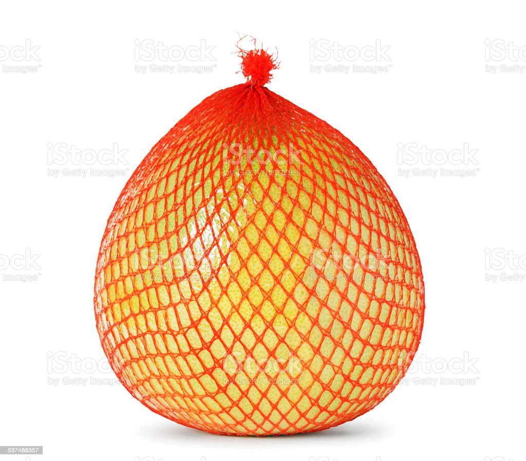 Yellow pomelo wrapped in plastic and mesh stock photo
