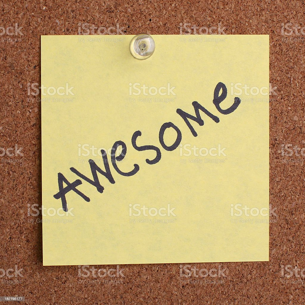 yellow post it note on cork board royalty-free stock photo