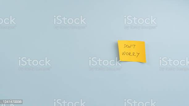 Yellow Post It Paper With Dont Worry Sign Stock Photo - Download Image Now