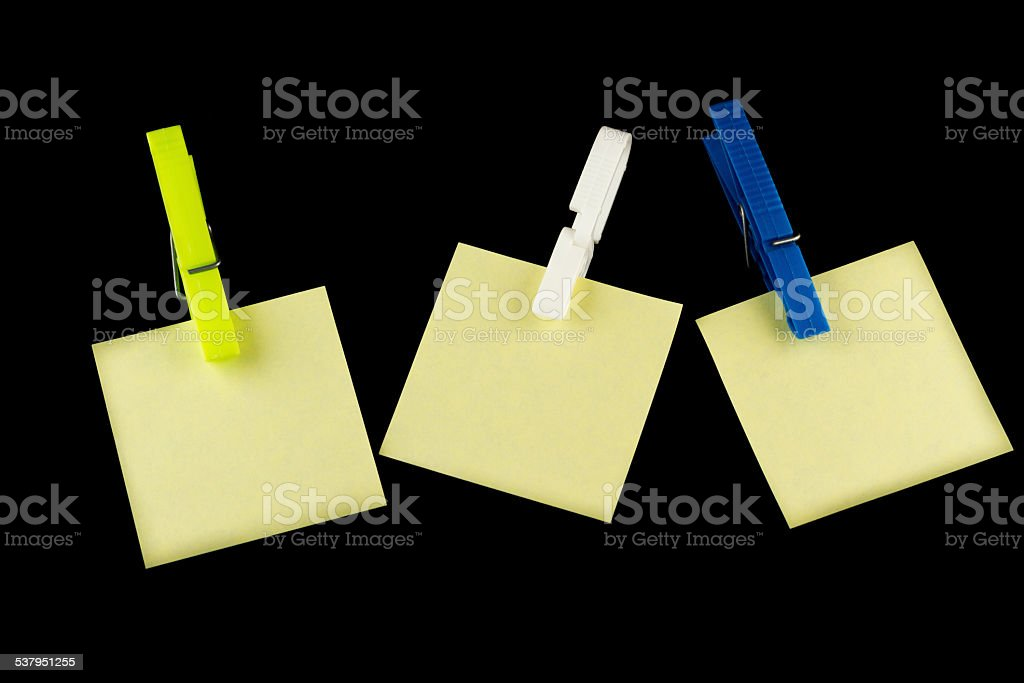 Yellow postit with clothespin stock photo