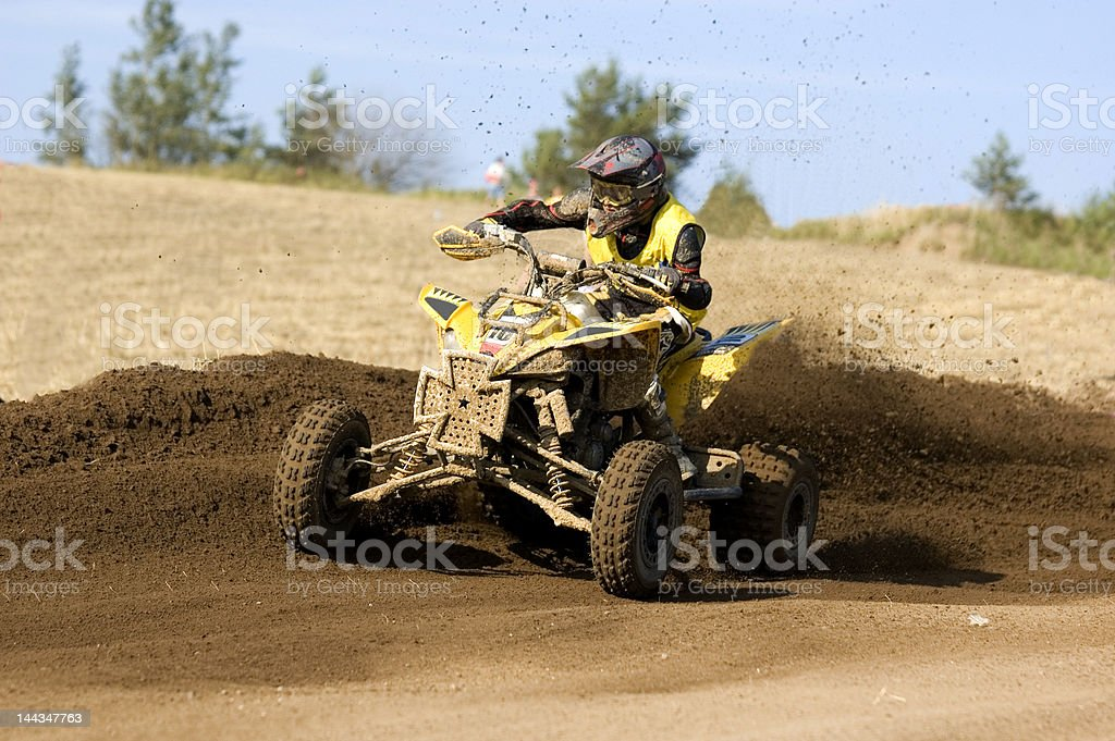 Yellow quad bike sliding stock photo
