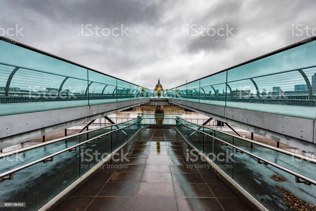 Yellow raincoat on bridge in London, UK 3 stock photo