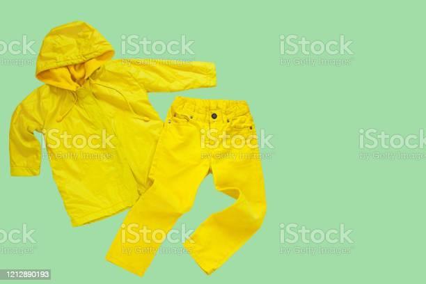 Yellow raincoat on neo mint background isolated happy funny kids picture id1212890193?b=1&k=6&m=1212890193&s=612x612&h=zcekni43 6oaqqm dym95nisqwkcntcji1iywtk5cqu=