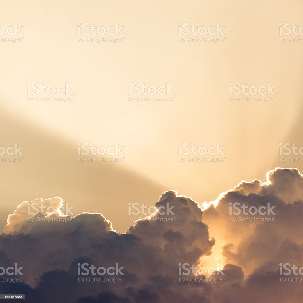 Yellow Rays of Sunshine in a Cloudy Sky royalty-free stock photo