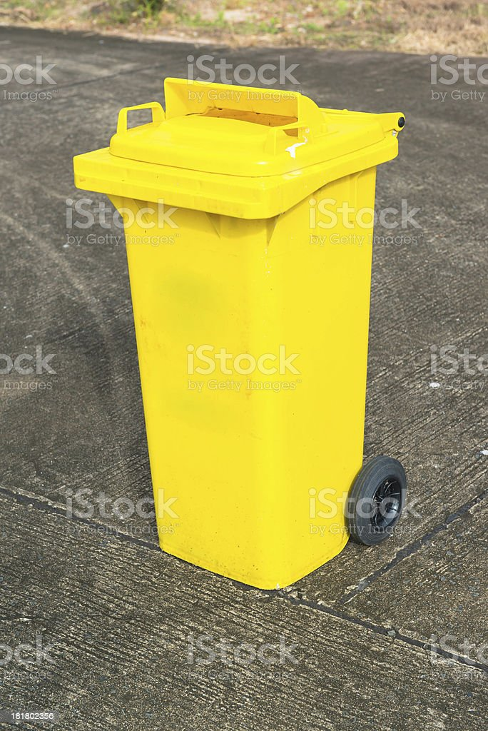 yellow recycling bin royalty-free stock photo